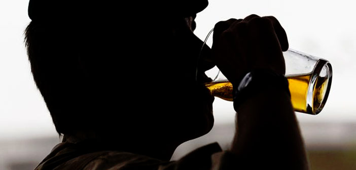 Man-drinking-beer-by-Defence-Images